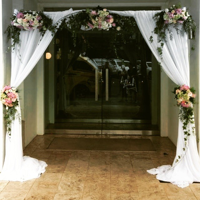 arch with curtain draping weddings of distinction. Black Bedroom Furniture Sets. Home Design Ideas